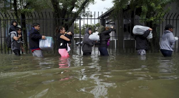 Texas suffers under the worst tropical storm in decades (Marie D De Jesus/Austin American-Statesman via AP)