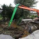 Heavy downpours left a trail of destruction across many towns and villages