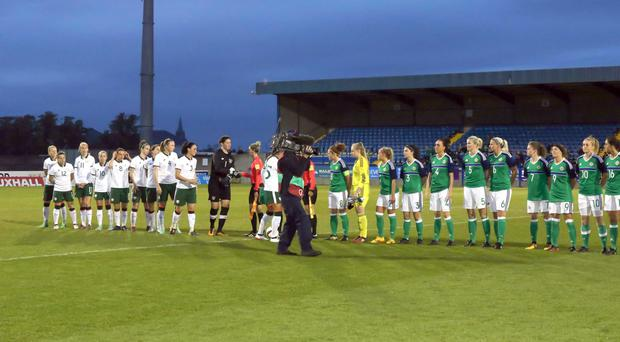 Northern Ireland and the Republic of Ireland teams shaking hands prior to kick off on Tuesday night