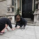 The London-Irish Abortion Rights campaigners mark over 200,000 tally marks in chalk representing the number of Irish women who have travelled to Britain for abortions