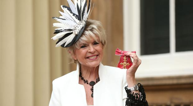 Gloria Hunniford with her OBE at Buckingham Palace