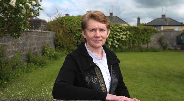 Local historian Catherine Corless at the site of a mass grave for children who died in the Tuam mother and baby home, Galway