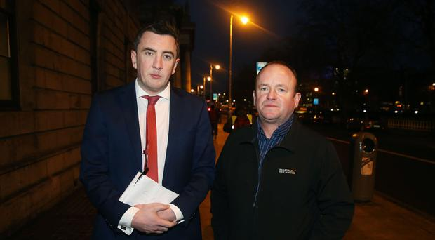 Seamus Ludlow's nephew Thomas Fox with solicitor Gavin Booth outside the court