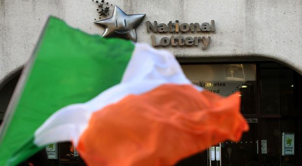 An Irish flag outside National Lottery Headquarters in Dublin