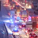 Emergency vehicles manoeuvre past stationary traffic on the M80 Haggs in Glasgow (Andrew Milligan/PA)