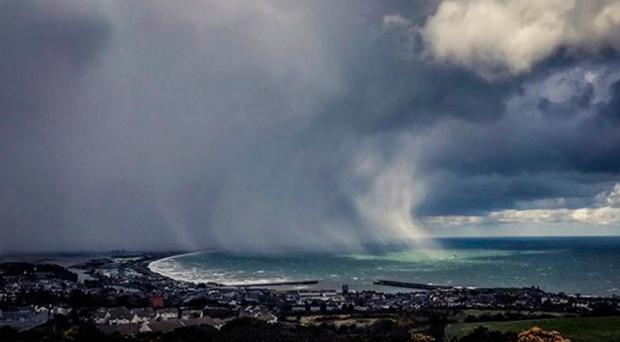 Storm clouds over Dublin Bay yesterday