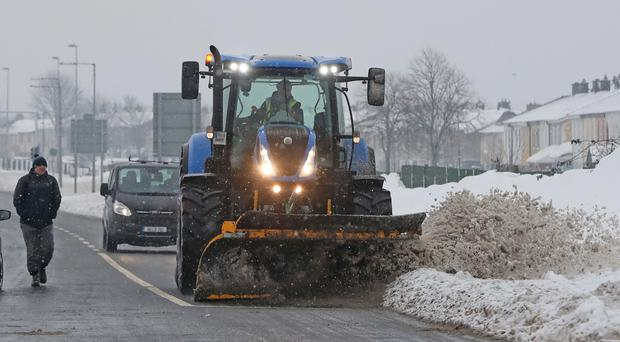 A snow plough clears roads in Tallaght, Dublin (Niall Carson/PA)