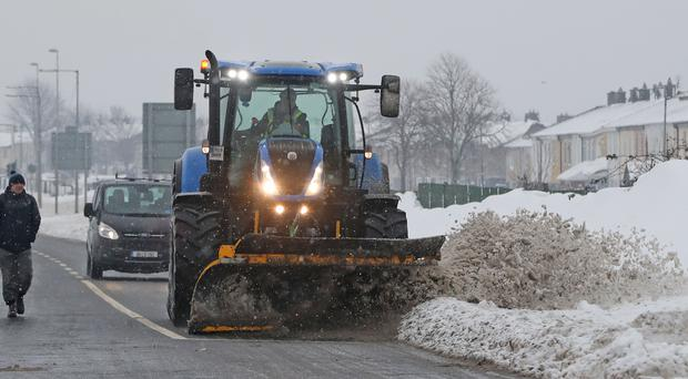 A snow plough clears roads in Tallaght, Dublin as a status orange weather alert remains in many counties in Ireland (Niall Carson/PA)