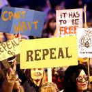 Demonstrators march through Dublin city centre calling for the repeal of the 8th amendment to the Irish constitution (Niall Carson/PA)