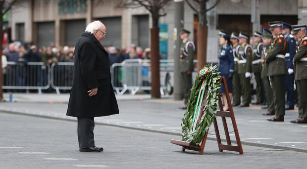President Michael D Higgins lays a wreath during the ceremony (Niall Carson/PA)