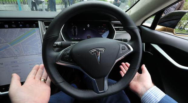 Dan Kiely owns a Tesla car with self-driving capabilities (Niall Carson/PA)