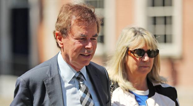 Former Justice Minister Alan Shatter and his wife Carol leaving the Disclosures Tribunal at Dublin Castle, Dublin, Ireland (Niall Carson/PA)