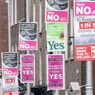 Campaign posters outside Government Buildings in Dublin (Niall Carson/PA)