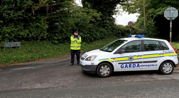 Gardai on Puck's Castle Lane in Rathmichael, Co Dublin (Donall Farmer/PA)
