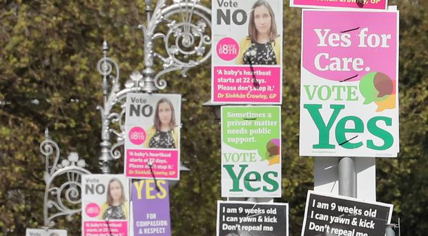 Posters call for Yes and No votes for a repeal of the Eighth Amendment of the Irish Constitution (Niall Carson/PA)