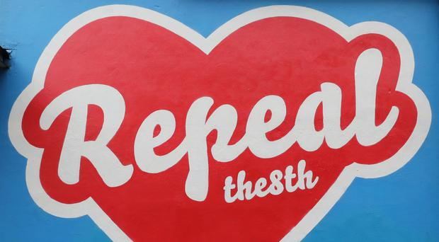 A mural calling for a repeal of the Eighth Amendment, as voters prepare to go to the polls (Niall Carson/PA)