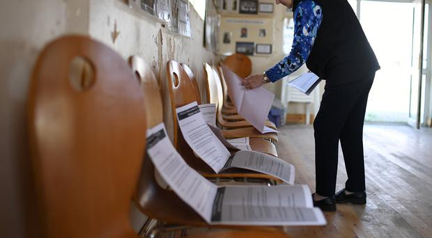 Presiding Officer Carmel McBride prepares the polling station for the referendum (Clodagh Kilcoyne/PA)