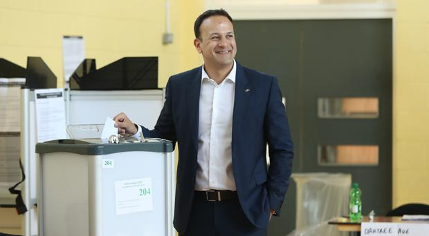 Taoiseach Leo Varadkar casts his vote at Scoil Thomas, Castlenock Dublin, as the country goes to the polls to vote in the referendum on the Eighth Amendment of the Irish Constitution (Niall Carson/PA)