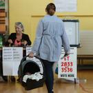 A woman in a polling station in Dublin (Niall Carson/PA)