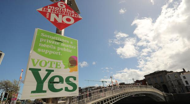 Posters call for Yes and No votes for a repeal of the Eighth Amendment (Niall Carson/PA)