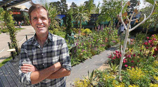 Designer Brian Burke in his garden at the Bord Bia Bloom garden festival in Phoenix Park, Dublin (Niall Carson/PA)