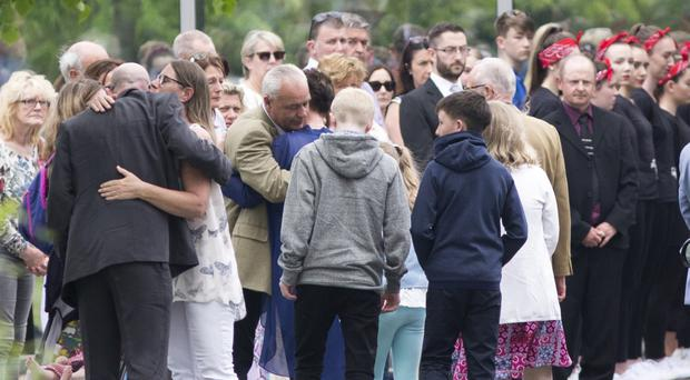 Family and friends at the funeral of 14-year-old Ana Kriegel