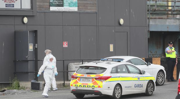 Forensic investigators and garda at the Bray Boxing Club where three people were shot (Brian Lawless/PA)