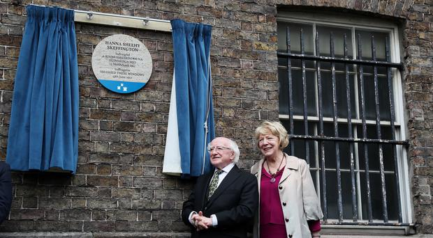 President Michael D Higgins and his wife Sabina unveil the Hanna Sheehy Skeffington commemorative plaque. (Brian Lawless/PA)