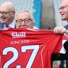 President of the European Commission Jean-Claude Juncker holding a Cork jersey. (Brian Lawless/PA)