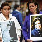 Donna Price (left) of PARC Road Safety Group and Caitriona Quinn hold a pictures of their children Darren and Cait. (Julien Behal/PA)