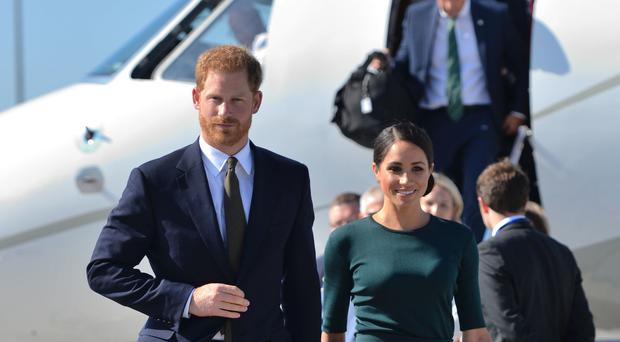 Newlyweds Harry and Meghan Undertake First Overseas Engagement