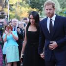 Harry and Meghan attend a Summer Party at the British Ambassador's residence at Glencairn House (Brian Lawless/PA)