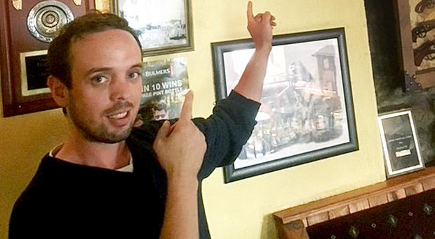 Damien Lyons points to a Spurs top of England captain Harry Kane on the wall on Molly's Bar in Connemara