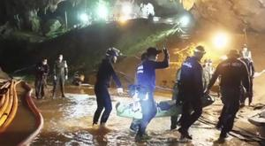 Rescuers hold an evacuated boy inside the Tham Luang Nang Non cave in Thailand (Thai NavySEAL Facebook Page via AP)
