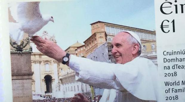 The 1 euro stamps show Pope Francis with a dove taking flight in St Peter's Square (Cate McCurry/PA)