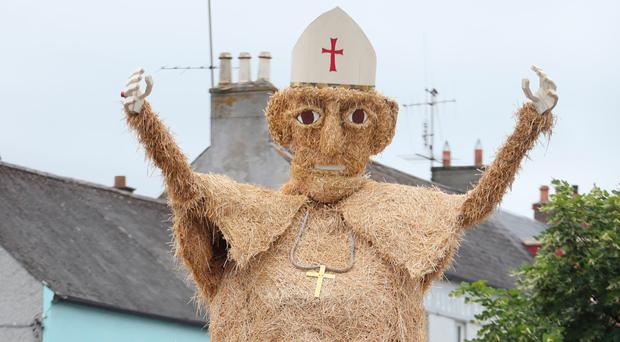 The scarecrow Pope and popemobile at the Durrow Scarecrow Festival in Co Laois