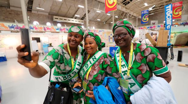 Pilgrims from Nigeria pose for a selfie before the opening ceremony yesterday evening of the World Meeting of Families at the RDS in Dublin. The event is the first of many to be held ahead of this weekend's celebrations to be led by Pope Francis