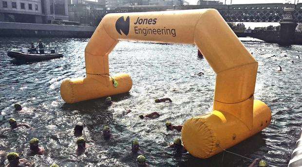 Competitors in the 99th annual Liffey Swim through Dublin (Aoife Moore/PA)