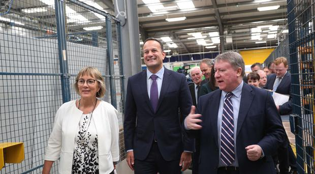 Leo Varadkar, with Julie Sinnamon, chief executive of Enterprise Ireland and Philip O'Doherty, managing director of E+I Engineering (Lorcan Doherty)