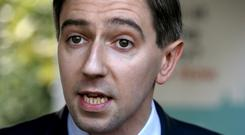 Ireland's Health Minister Simon Harris instructed Justice Charles Meenan to look at pathways of dealing with claims outside the court process (Brian Lawless/PA)