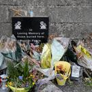 Tributes left at the site of the former home for unmarried mothers (Niall Carson/PA)