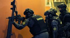 Members of the Garda Emergency Response Unit (ERU) during Operation Barracuda, a training exercise simulating a terrorist attack, at Dublin City University (Brian Lawless/PA)