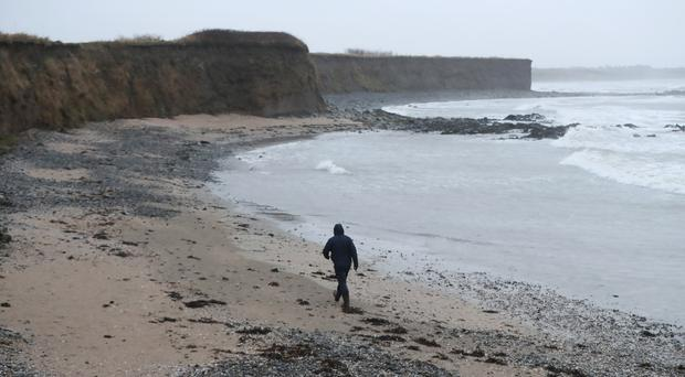 Gardai investigating the discovery of a newborn baby girl partly buried on a beach in Ireland have ruled out foul play (Niall Carson/PA)