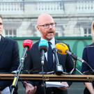 Fianna Fail health spokesman Stephen Donnelly (centre) along with James Browne and Lisa Chambers speaking to the media at Leinster House in Dublin. (Brian Lawless/PA)