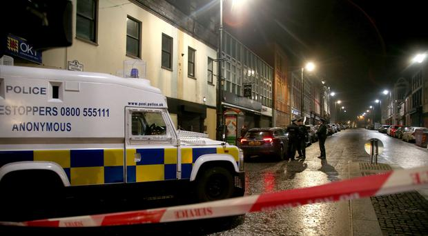 Police near the scene of a suspected car bomb on Bishop Street in Londonderry