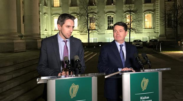 Health Minister Simon Harris and Finance Minister Paschal Donohoe speaking at Government Buildings on Monday evening after the Labour Court intervention in the nurses' dispute (Michelle Devane/PA Wire).