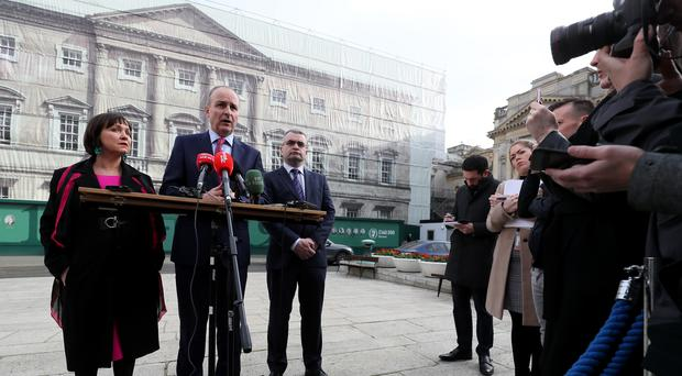 Fianna Fail leader Micheal Martin (centre) deputy Leader Dara Calleary (right) and Fiona O'Loughlin TD outside Leinster House (Brian Lawless/PA)
