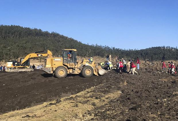 Rescuers use a digger at the scene of an Ethiopian Airlines flight that crashed shortly after take-off (Yidnek Kirubel/AP)
