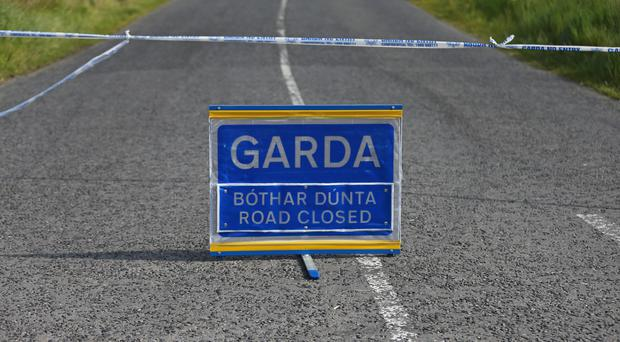 The road was closed for forensic examination (Niall Carson/PA)
