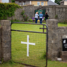 Members of the public at the site of a mass grave for children who died in the Bon Secours Mother and Baby Home in Tuam